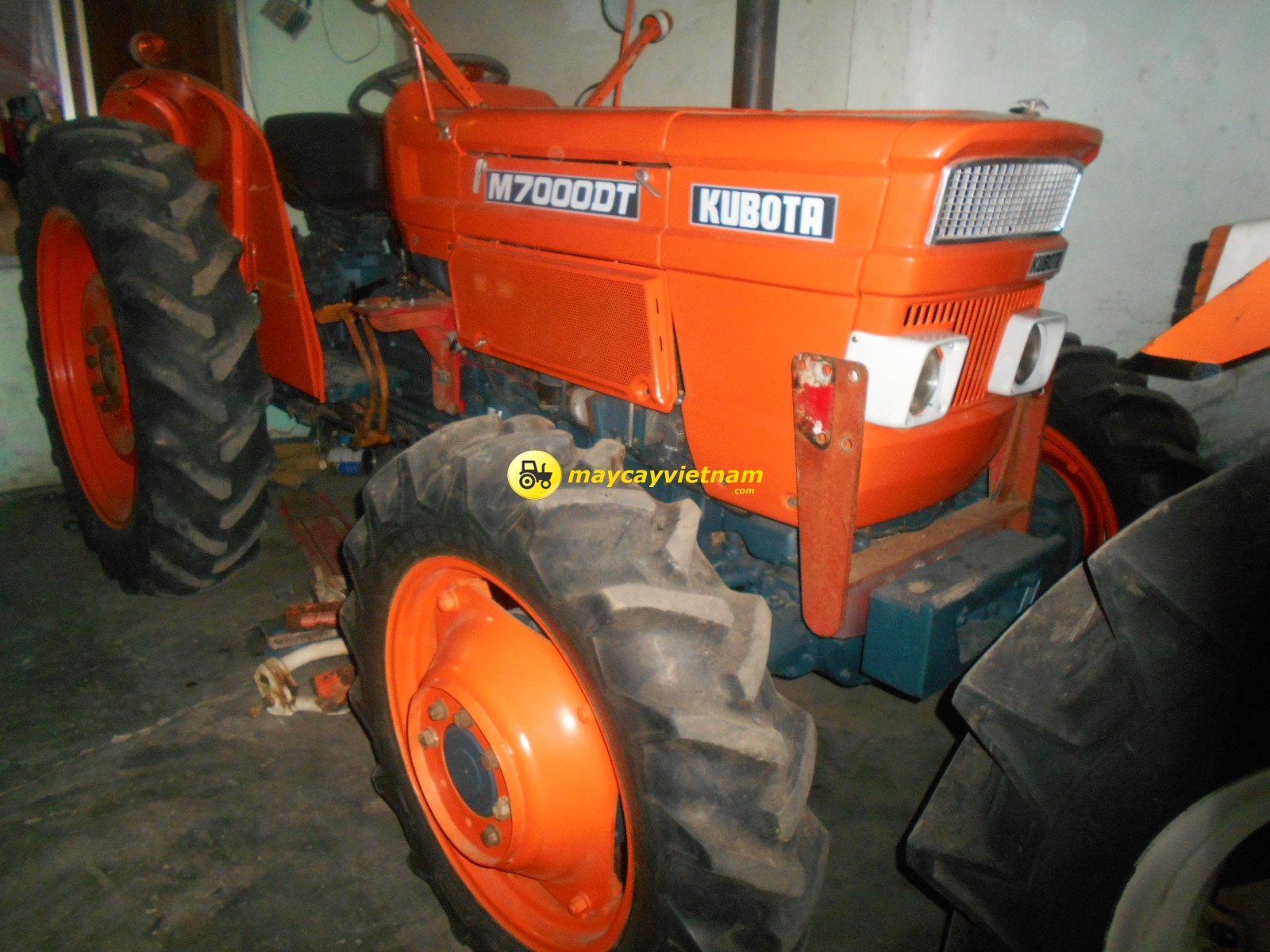 May Cay Kubota M7000-DT